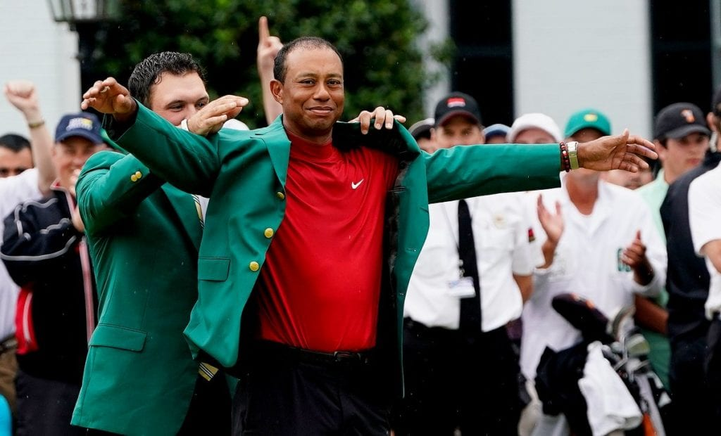 Tiger Woods dons the Green Jacket for a fifth time