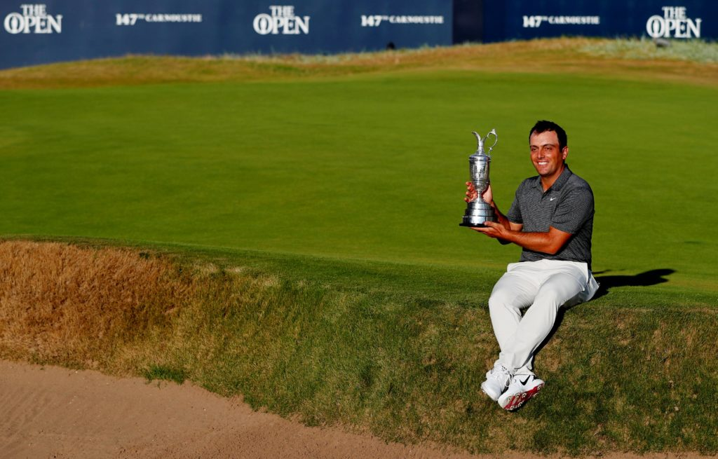 Francesco Molinari celebrates with the Claret Jug after winning the 147th Open Championship REUTERS/Paul Childs