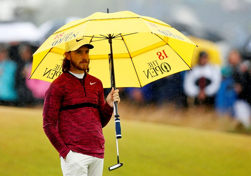 The 147th Open Championship - Carnoustie, Britain - July 20, 2018 England's Tommy Fleetwood holds an umbrella during the second round REUTERS/Andrew Yates