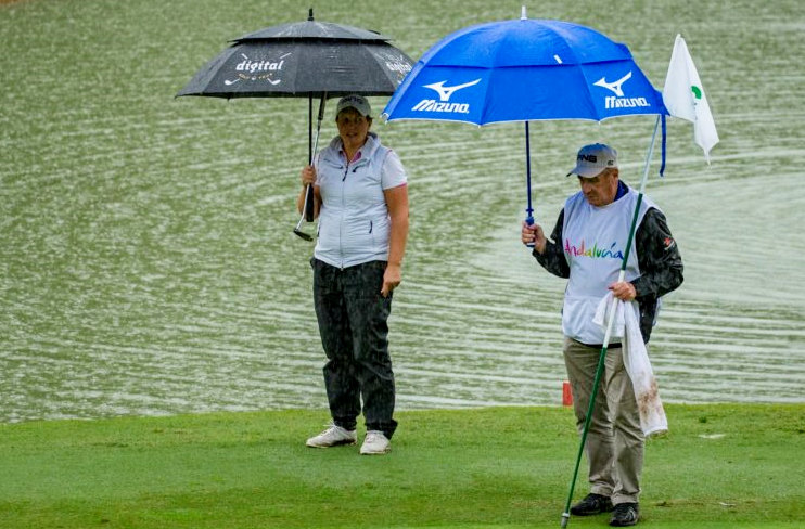 Michele Thomson, Anne Van Dam and Liz Young share the overnight lead after heavy rain halted first round play on Thursday