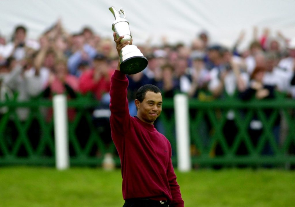 Tiger Woods holds the Claret Jug aloft after winning the Open golf championship with a final score of 19 under par at St. Andrews, Scotland in 2000