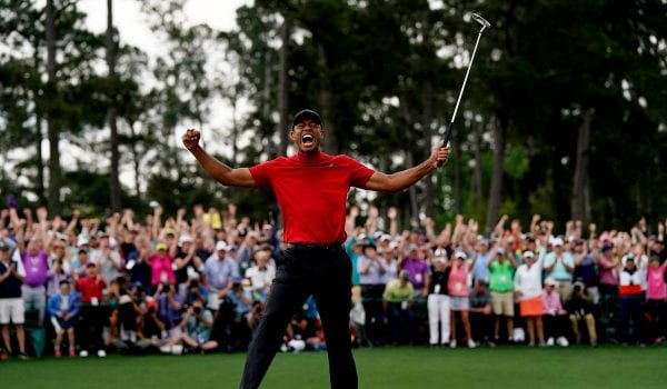 Tiger Woods celebrates winning his 15th major title
