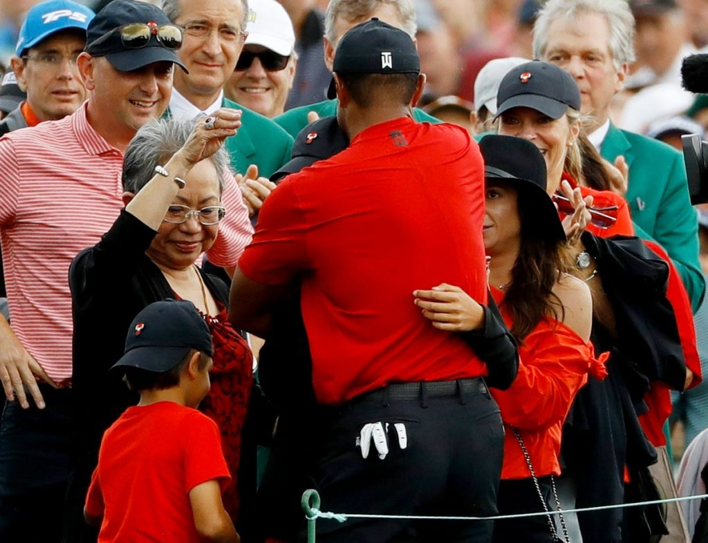 Tiger Woods hugs his family after sealing an emotional victory