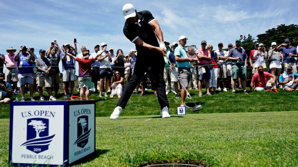 Brooks Koepka hits his tee shot on the ninth hole during a practice round for the US Open (David J Phillip/AP)