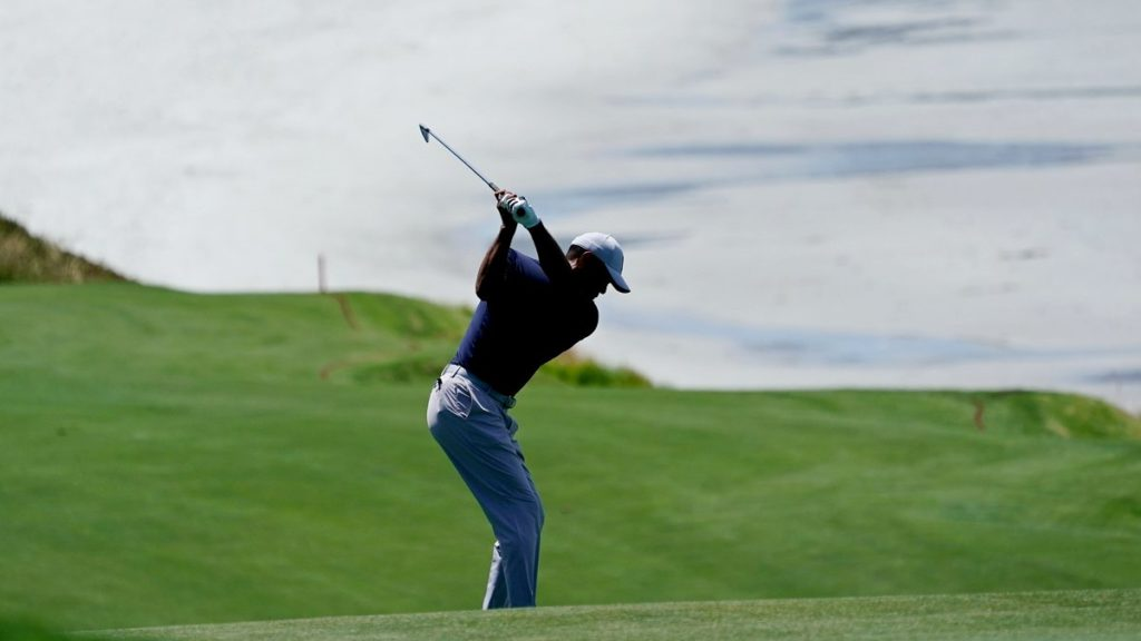 Tiger Woods hits on the ninth hole during a practice round for the US Open at Pebble Beach (David J. Phillip/AP)