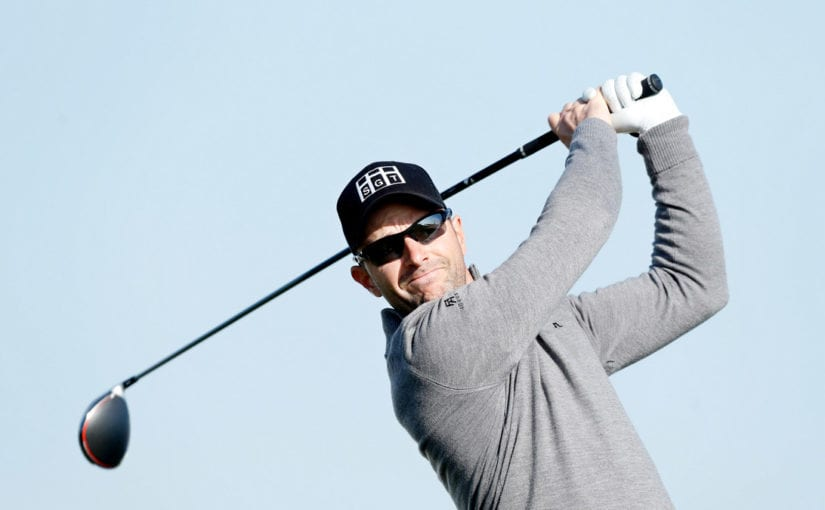 Schneider shoots course record to lead in Austria
