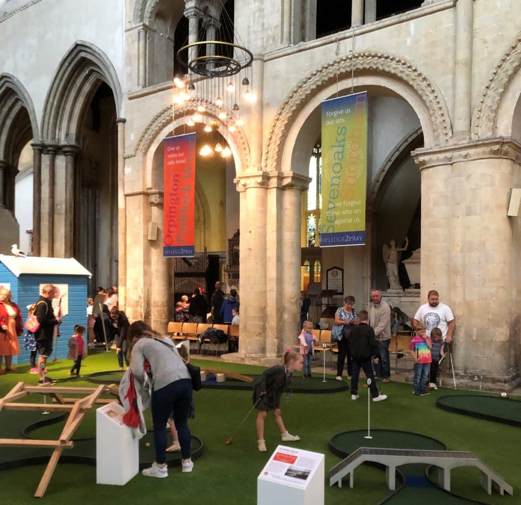 Crazy Cathedral - Rochester. Amid some controversy, a 9-hole crazy golf course has been laid out in the central aisle of the medieval cathedral